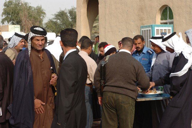 """Tribal sheiks, Iraqi Security Force leaders and government officials dine together and talk about reconciliation during an """"Awakening"""" meeting in Assiriyah, Iraq Dec. 6."""