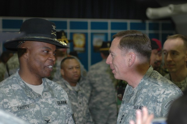 """Colonel Stephen Twitty, commander of the 4th Brigade Combat Team, 1st Cavalry Division (left), speaks with Gen. David Petraeus, commander of Multinational Forces - Iraq, following the brigade's transfer of authority ceremony at Forward Operating Base Marez, Iraq Dec. 11.  During the event the 4th """"Long Knife"""" Brigade Combat Team, 1st Cavalry Division transferred responsibility for operations in northern Iraq to the 3d Armored Cavalry Regiment."""