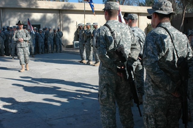 "Lt. Col. Christopher Joslin, commander of 2nd ""Lobo"" Battalion, 227th Aviation Regiment, 1st Air Cavalry Brigade, 1st Cavalry Division, (left), addresses some of his Soldiers during a colors casing ceremony Dec. 10 at Taji, Iraq. Joslin told his Soldiers they should be proud of their accomplishments in Iraq."""