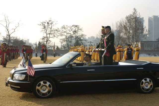 """Gen. George William Casey Jr., the U.S. Army Chief of Staff, inspects Republic of Korea troops during an honor guard ceremony held at the R.O.K. Ministry of National Defense in Seoul, South Korea Dec. 15. Casey was awarded the Bokuk Medal by Gen. Park, Heung-ryul, the R.O.K. army Chief of Staff . Bokuk means """"defending the country""""."""