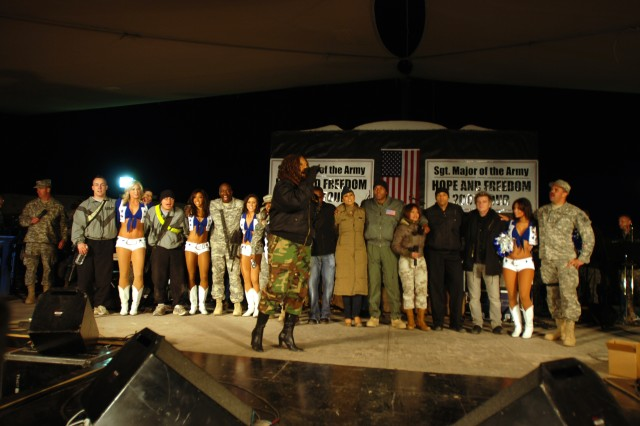 "The band ""Downrange"" performs their final song with other tour members and Soldiers during the Sergeant Major of the Army Hope and Freedom tour, Dec. 16, at Camp Striker, Baghdad."