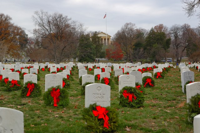 Ten thousand evergreen wreaths adorn graves at Arlington National Cemetery, placed Dec. 15 as part of the annual Wreaths Across America campaign to honor those who served.