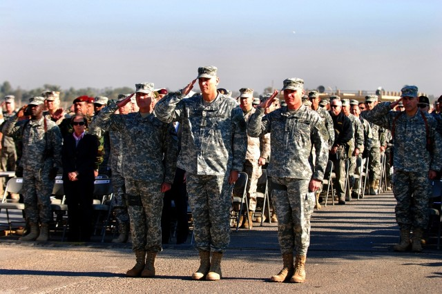 CAMP LIBERTY, Iraq - Maj. Gen. Joseph Fil, Jr. (left), outgoing Multi-National Division-Baghdad commanding general, Lt. Gen. Raymond Odierno (center), Multi-National Corps-Iraq commanding general and Maj. Gen. Jeffery Hammond, incoming MND-B commanding general salute the colors during the MND-B transfer of authority ceremony Dec. 19 at Camp Liberty, Iraq.