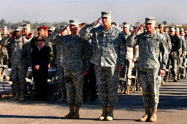 """Maj. Gen. Joseph Fil Jr. (left), outgoing Multi-National Division Baghdad commanding general, Lt. Gen. Raymond Odierno (center), Multi-National Corps Iraq commanding general and Maj. Gen. Jeffery Hammond, incoming MND-B commanding general salute the colors during the MND-B transfer of authority ceremony Dec. 19 at Camp Liberty, Iraq. """""""