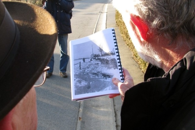 Ted Paluch, left, a survivor of the 1944 Malmedy massacre of 84 U.S. Soldiers in Belgium, compares a photo taken of the scene then and how the area looks now.