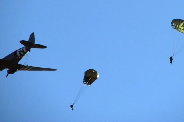 Parachutists drop from a World War II C-47 Dakota during Battle of the Bulge ceremonies held in Bastogne, Belgium, Dec. 15.