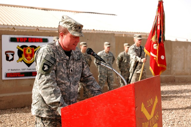 CAMP LIBERTY, Iraq - Lt. Col. David Burwell, commander of the 1st Battalion, 320th Field Artillery Regiment, 101st Airborne Division 'Top Guns,' addresses his troops before a ceremony to commemorate the day they received their combat patches at their battalion headquarters Dec. 22. Combat patches signify that a Soldier has been deployed to a combat zone.