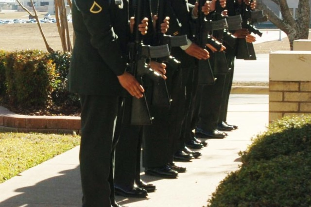 Soldiers out of Fort Hood, Texas, render the salute while under arms to pay tribute to the memory of Sgt. Alfred Paredez of Las Vegas, Nev., during a memorial ceremony held at the 1st Cavalry Division Chapel Dec. 20. The Soldier with Headquarters and Headquarters Company, 1st Battalion, 8th Cavalry Regiment, 2nd Brigade Combat Team, passed away Nov. 20.