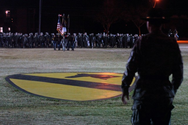 Brig. Gen. Frederick Rudesheim, the Fort Hood installation commander, watches as approximately 200 Soldiers from the 1st Cavalry Division's 2nd Brigade Combat Team cross Cooper Field during the early morning hours of Dec. 25.