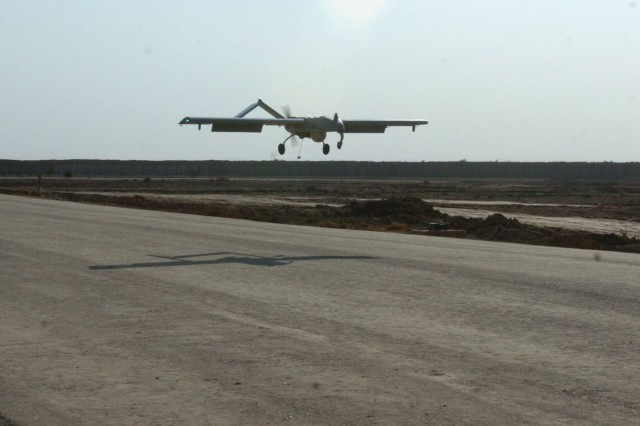 A Shadow 200 RQ-7B UAV begins the landing sequence following a flight to support troops with another set of eyes outside Forward Operating Base Kalsu,