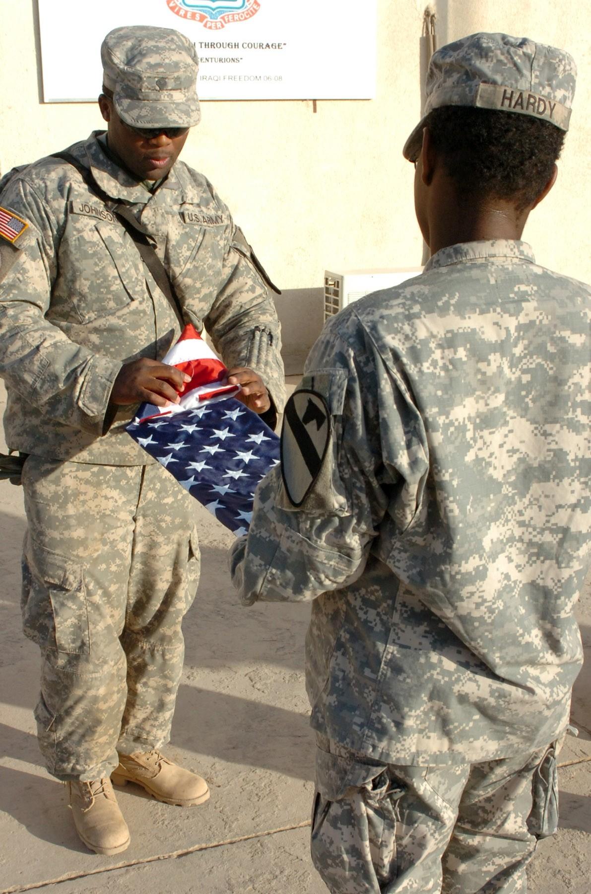 Ironhorse Brigade troopers unfurl gift flags during