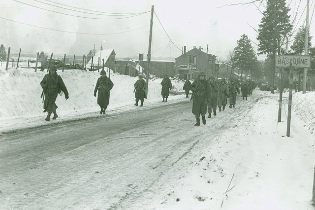 GIs slog it out during the harsh winter weather in Bastogne, !944 (World War II Signal Corps Collection).