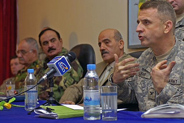 Col. Jon Lehr, commander of the 4th Stryker Brigade Combat Team, 2nd Infantry Division from Fort Lewis, Wash., addresses leaders of Diyala province, Iraq, during a tribal reconciliation meeting at the Governor's Center in Baquba, Iraq, Dec. 27.
