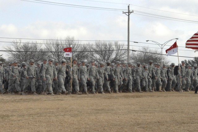 Soldiers from the 2nd Brigade Combat Team and the 1st Air Cavalry Brigade, 1st Cavalry Division, head towards their welcoming ceremony and family and friends when they returned to Fort Hood, Texas, on Sunday, January 6, 2008.