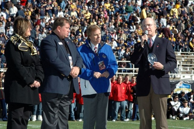 Secretary of the Army Pete Geren (right) receives the Great American Patriot Award during halftime at the Armed Forces Bowl football game in Fort Worth, Texas, Dec. 31.