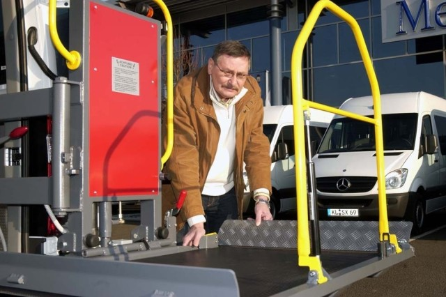 Gerhard Heil, U.S. Army Garrison Kaiserslautern transportation motor pool manager, tests a wheelchair ramp installed on one of the 14 vans meant for Warrior Transition Units in Europe.