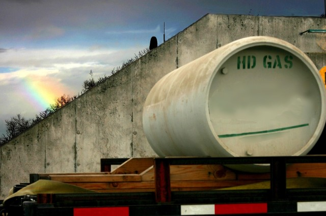 """A bulk container of mustard agent is loaded on a truck outside a storage igloo as it is prepared for transport to the disposal facility. While marked as """"gas,"""" chemical agents are actually liquid in storage. Detonation would render the liquid into gas.  """""""