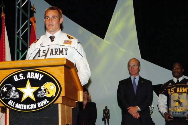 Secretary of the Army Pete Geren listens as an awardee talks about his achievements during the All-American Bowl Awards Dinner in San Antonio, Texas, Jan. 4. ""