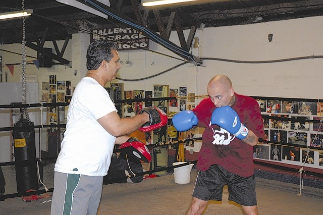 In preparation for his upcoming bout, Luis Collazo works the focus mitts with head trainer, Nirmal Lorick, at the White Rock boxing gym.