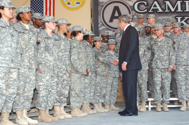 President George W. Bush shakes hands with a Soldier after his speech at Camp Arifjan, Kuwait, Jan 12. Bush thanked troop and their Families for their hard work and sacrifice.