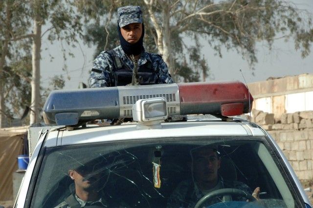 Iraqi police provide security.