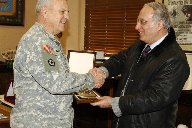 The commanding general of the United States Army Training and Doctrine Command, Gen. William S. Wallace welcomes the Iraqi Minister of Defence Abdul Qadir Mohammed Jassim to HQ TRADOC. The Minister concluded a visit to the U.S. with briefings at TRADOC and the U.S. Joint Forces Command in Suffolk, Va. (Photo by James Wagner)