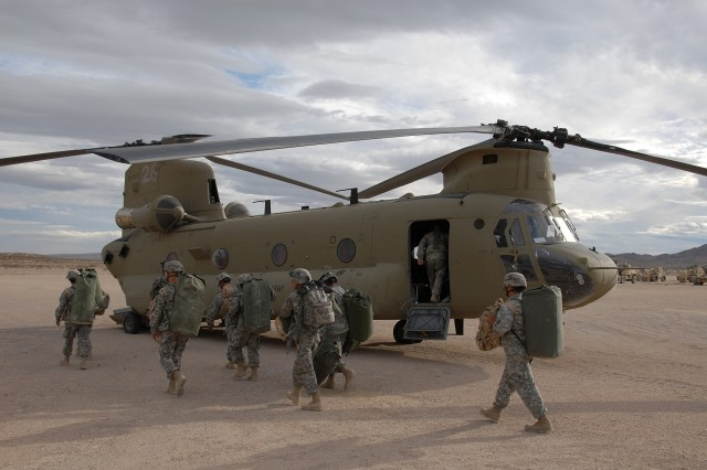Soldiers prepare to board a CH-47 Chinook Fox model at the National Training Center, Fort Irwin, Calif., Nov. 11. The soldiers are from the 4th Infantry Division during their pre-deployment training at NTC