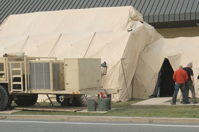 A Tactical Operations Center training shelter at Tobyhanna Army Depot has all the equipment a field TOC would have, including a generator and an environmental control unit.    Depot instructors have trained hundreds of Soldiers and Army civilians around the world in TOC and other communications systems.