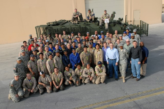 The entire work force at the 1-401st Army Field Support Brigade Stryker Battle Damage Repair Facility, Camp As Sayliyah, Qatar, celebrate the milestone Jan. 12 as an ICV 513 prepares for transit.