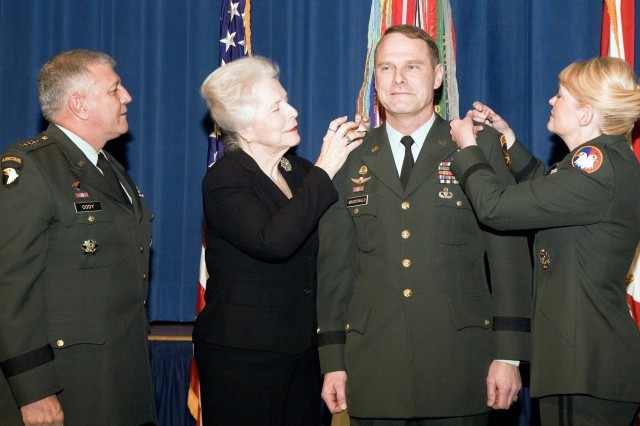 Maj. Gen. John Macdonald receives his second star from his mother, Martha Macdonald, second from left, and his wife, Brig. Gen. Anne Macdonald, right, during a promotion ceremony Jan. 11 at the Pentagon. Gen. Richard A. Cody, left, vice chief of staff of the Army, hosted the promotion ceremony. Maj. Gen. Macdonald is the commanding general of the Family and Morale, Welfare and Recreation Command in Alexandria, Va., and deputy commanding general of the U.S. Army Installation Management Command in Arlington, Va., and Brig. Gen. Macdonald is chief of staff of the U.S. Army Reserve Command at Fort McPherson, Ga.