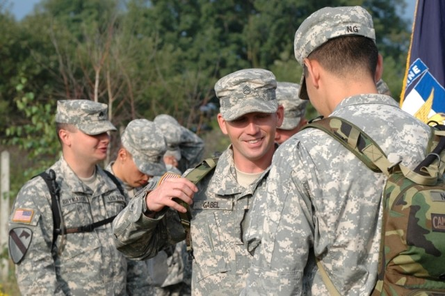 Staff Sgt. Michael Gabel shares a laugh with Capt. Jonathan Ng at one of the camping spots during the Polish Pilgrimage in August. Gabel, who was recently killed in Afghanistan, donated more than $20,000 of his life insurance to the 173rd Airborne Brigade Combat Team's rear detachment.