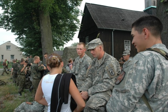 Staff Sgt. Michael Gabel talks with a local girl during the Polish Pilgrimage last August.  The pilgrimage offered SETAF Soldiers the opportunity to experience a different culture and meet other soldiers from five different countries. Gabel, who was recently killed in Afghanistan, donated more than $20,000 of his life insurance to the 173rd Airborne Brigade Combat Team's rear detachment.