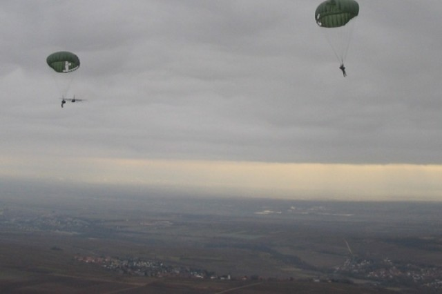 Members of the 67th Forward Surgical Team (Airborne) drift over Germany during a recent parachute jump. The 67th FST recently attained airborne status and was accordingly allowed to don the maroon beret.