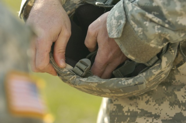 A jumpmaster with the XVIII Airborne Corps Special Troops Battalion readjusts the pads of a Corps' Soldier's Advanced Combat Helmet during manifest call for the Corps' final pre-deployment jump Jan. 15, 2008 at Fort Bragg, N.C.