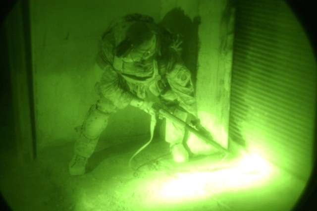 U.S. Army Sgt. Christopher Harmon, from Bravo Troop, 5th Squadron, 3rd Battalion, 1st Brigade Combat Team, 73rd Cavalry Regiment, 82nd Airborne Division, executes a shotgun breach of a door lock during a house by house clearance operation in Aksabah, Iraq, Aug. 17, 2007.  The Army recently approved a new anti-material cartridge, the M1030.  The M1030 is designed as a breaching munition, used for defeating wooden doors, deadbolts, knobs, hinges and padlock hasps.  The design of the munition minimizes ricochet hazards currently associated with buckshot breaching and provides a much safer alternative to the Soldier.