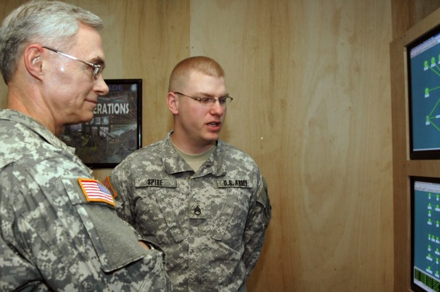 Lt. Gen. Jeffrey A. Sorenson, Army chief information officer, talks about network operations with Staff Sgt. Matthew Spire, 2-3 Brigade Troops Battalion, 2nd Brigade Combat Team, 3rd Infantry Division, NETOPS noncommissioned officer in charge, during a visit to Forward Operating Base Kalsu Jan. 19.