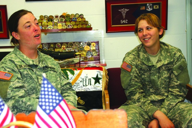 PVT Michelle Silverman (left) and PVT Amber Pearson (right) discuss their experiences during military training.