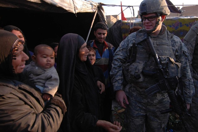 1st Lt. Austin Dziengelewski, a platoon leader with Company B, 2nd Battalion, 325th Airborne Infantry Regiment, 2nd BCT, 82nd Airborne Division, talks with a family of displaced squatters after discovering their refugee camp during a patrol Jan. 14. Later that night, the paratroopers dropped off some supplies to help the family get through the winter.