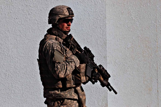 Staff Sgt. Aaron McCurdy, a section leader with a cavalry troop attached to the 2nd Battalion, 325th Airborne Infantry Regiment, 2nd BCT, 82nd Airborne Division, patrols the streets of East Baghdad's Sha'ab neighborhood Jan. 16.