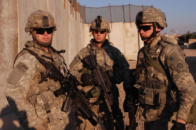 Sgt. Christopher Walsh, Pfc. Brett Nissen and Pfc. Adam Johnson of Company B, 2nd Battalion, 325th Airborne Infantry Regiment, 2nd BCT, 82nd Airborne Division, prepare to move out on a patrol from the Sha'ab Joint Security Station in eastern Baghdad Jan. 15.