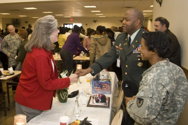 More than 150 employees attended the Dr. Martin Luther King Jr. breakfast held at Café East on Jan. 15.  At the conclusion of the event, June Woodard credits guest speaker AMC's Col. Archie Davis with an outstanding message.  Standing to his left is Depot Commander Col. S. B. Keller.