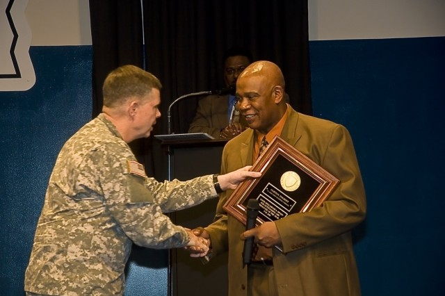 Clifton Tolbert (right) is presented the Louis Dellamonica Award for Outstanding U.S. Army Materiel Command Personnel of the Year Award for 2006 by Brig. Gen. William Phillips. This award was one of only ten presented throughout the Army.