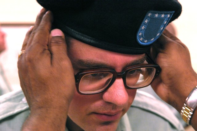 Pvt. Jeffrey  Lunz is issued his beret.