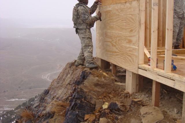 Sgt. Carlos Bell nails the wall for a bunker.
