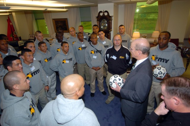 Members of the 2008 All-Army Soccer Team meet with Pete Geren, the 20th Secretary of the U.S. Army, in his office Jan. 22 at the Pentagon. The All-Army Team is training for the 2008 Armed Forces Men's Soccer Championship Tournament Jan. 31 through Feb. 5 at Marine Corps Air Station Cherry Point, N.C.