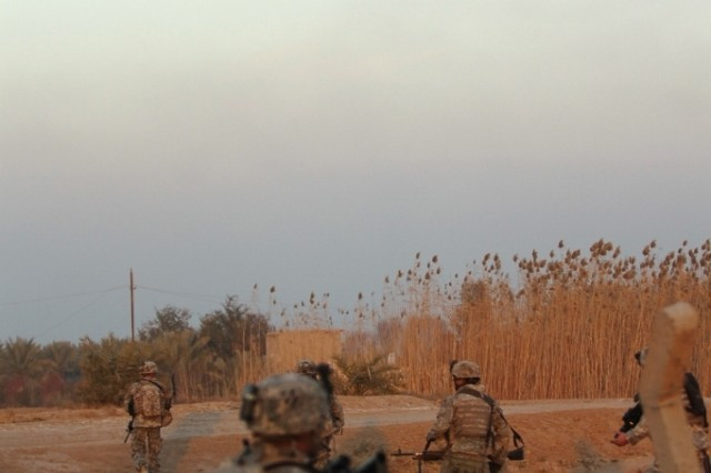 Soldiers of Company A, 1-30th Infantry, move over terrain in Southern Arab Jabour Jan. 21 during Operation Browning.