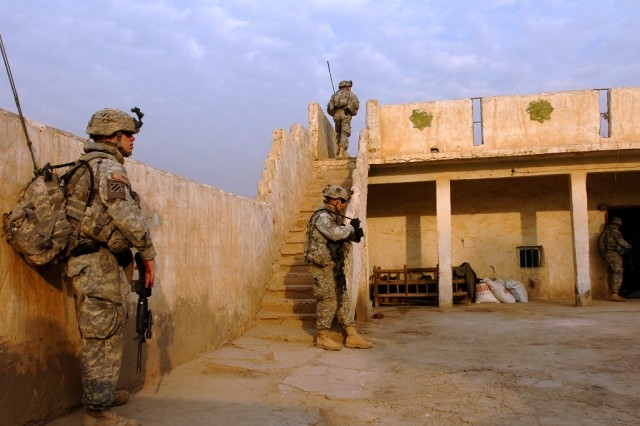 Pfc. Matthew Workman (left), a forward observer, with Company A, 1-30th Infantry, pauses with his fellow Soldiers during a security halt while on patrol in southern Arab Jabour Jan. 20. Workman and Company A troops air assaulted into the region to track down insurgent cells.