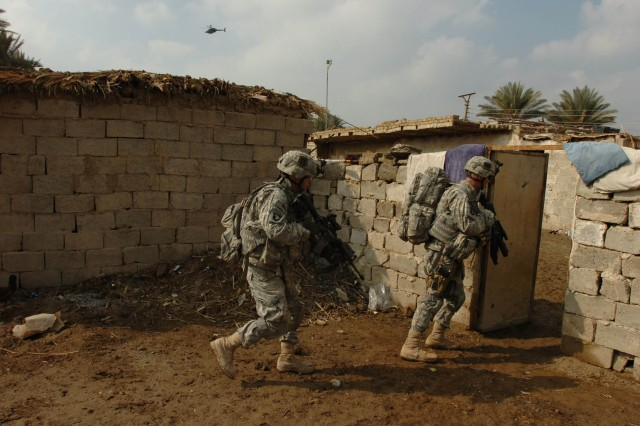 Soldiers from Company C, 3-187th Infantry,101st Airborne Division (Air Assault), clear a courtyard in the Sa'id Abdullah Corridor during Operation Iron Boston Jan. 27.