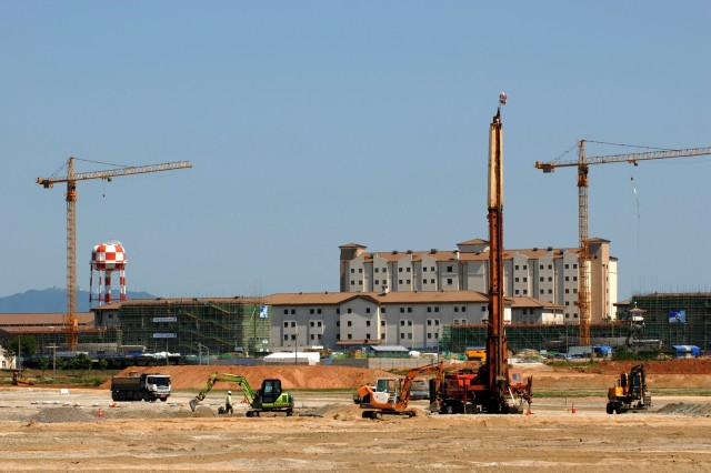 Contractors fill in what used to be rice paddies for building around Camp Humphreys, South Korea. In the background of this photo taken in June, new barracks are being built on a site that a decade ago was a tent city.