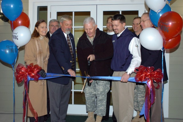 Left to right: Northeast Region Director Diane Devens, Northeast Region Director of Morale, Welfare and Recreation Lee Dexter, Fort Eustis MWR Project Manager Stephen Raschke, Fort Eustis Commanding General Brig. Gen. James Chambers, The Stellar Group Vice President of Business Development Ryan Foster, The Pines Golf Course PGA Manager Andy Weissinger, Fort Eustis Garrison Commander Col. Andrew Bowes and Army Family and MWR Command Food Services Division Chief Bill Sewell officially open the new clubhouse at Fort Eustis during a ribbon-cutting ceremony Jan. 25.